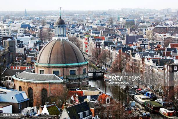 High view of the Singel Canal and the Round Lutheran Church of Amsterdam.