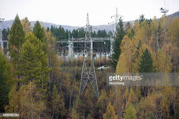 High voltage electricity cables hang from pylons at the Manakanskaya hydroelectric power station operated by Polyus Gold International Ltd on the...