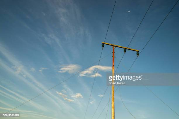 High voltage electricity pole with clear blue sky
