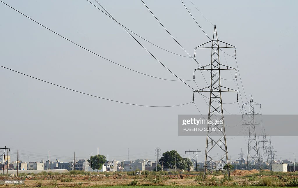 High voltage lines connect at a power tower near a electricity sub station in the Northwestern Indian city of Amritsar on May 16 2013 India which has.