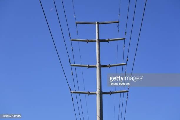 high voltage modern power line - rafael ben ari fotografías e imágenes de stock