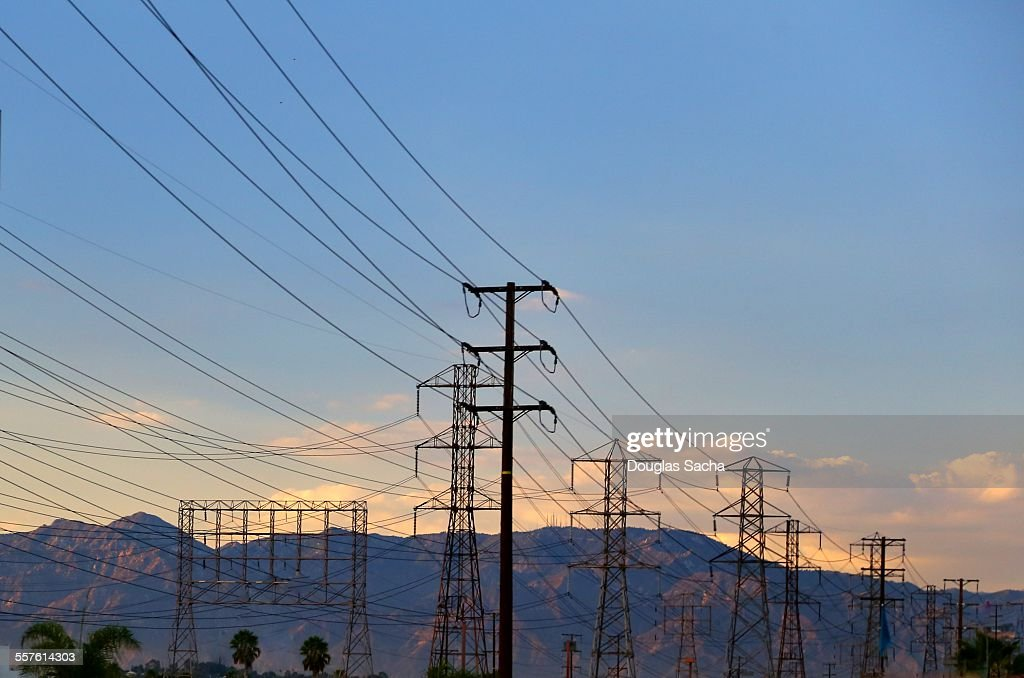 High voltage power lines in the sky : Stock Photo