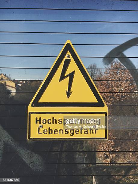 High Voltage Sign On Glass