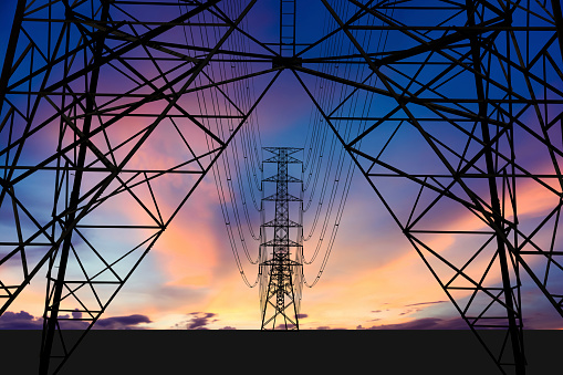 High voltage tower and Colorful sky. 858316674