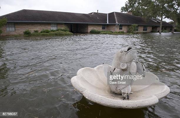 High water floods a home ahead of Hurricane Ike's arrival September 12 2008 in Dickinson Texas An advisory for some parts of coastal Texas advised...