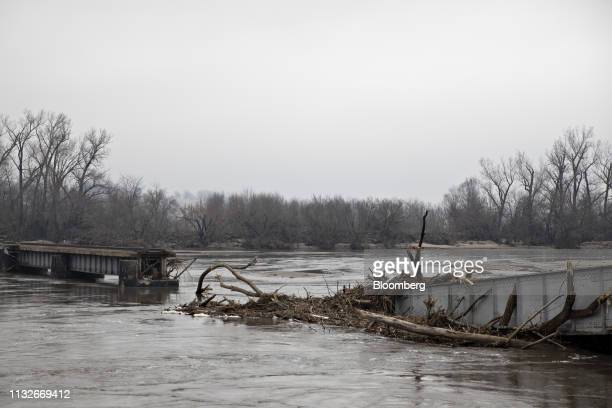 High water in the Platte River surrounds a collapsed section of a Burlington Northern Santa Fe LLC rail bridge in La Platte Nebraska US on Sunday...