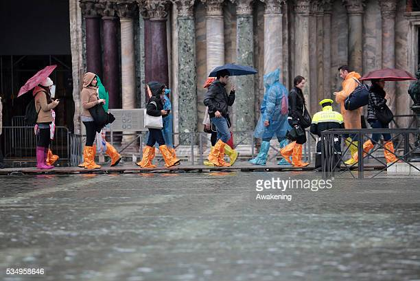 High water in Venice on the day of Cyclone Cleopatra caused damage and at least 16 people dead in Sardinia