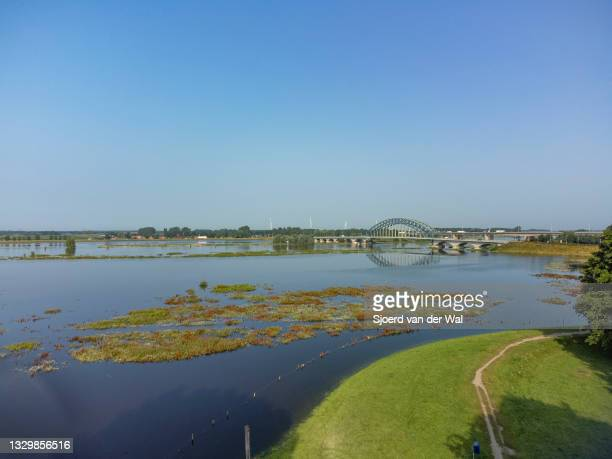 High water level on the floodplains of the river IJssel at the IJsselbrug bridge ion July 21 in Zwolle, Overijssel, The Netherlands. Aerial drone...