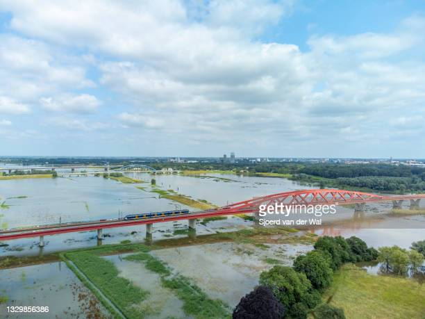 High water level on the floodplains of the river IJssel at the Hanzeboog train bridge ion July 20 in Zwolle, Overijssel, The Netherlands. Aerial...