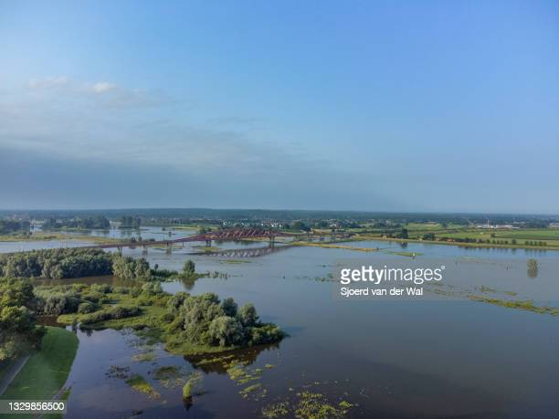 High water level on the floodplains of the river IJssel at the Hanzeboog train bridge ion July 21 in Zwolle, Overijssel, The Netherlands. Aerial...