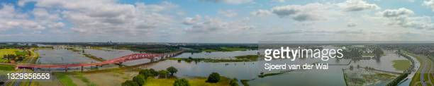 High water level on the floodplains of the river IJssel at the Hanzeboog train bridge on July 20 in Zwolle, Overijssel, The Netherlands. Aerial drone...