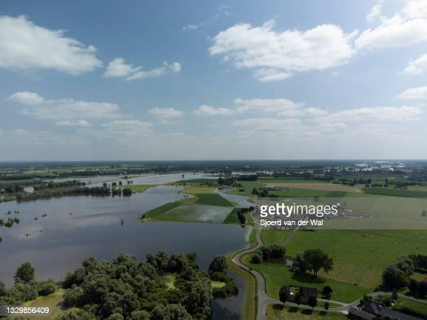 High water level on the floodplains of the river IJssel between Zwolle and Deventer on July 20 in Wijhe, Overijssel, The Netherlands. Aerial drone...
