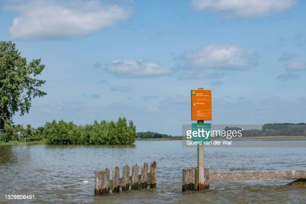 High water level on the floodplains of the river IJssel between Zwolle and Deventer on July 20 in Welsum, Overijssel, The Netherlands. The gate...