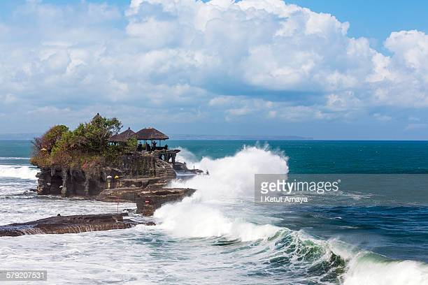 high wave over tanah lot temple - tanah lot stock pictures, royalty-free photos & images