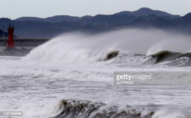 High waves batter a breakwater at Komatsu beach in the city of Tokushima, Tokushima prefecture, in western Japan on September 21, 2011. Powerful...