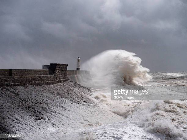 High waves batter the sea wall at Porthcawl South Wales as Storm Francis hits the South Wales Coast.