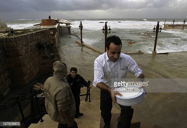 High waves flood a fish restaurant on the Mediterranean coast of the northern Lebanese port of Byblos as heavy winds and rain whipped across Lebanon...