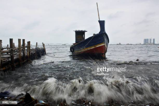 High waves hit the fishery port Muara Angke North Jakarta on December 20 2017 Bad weather and high waves due to the transition of summer to the rainy...