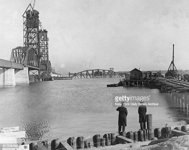 High winds blew connecting link of new bridge to be used by Lehigh Pennsylvania Railroad between Newark and Bayonne off piles and into the bay