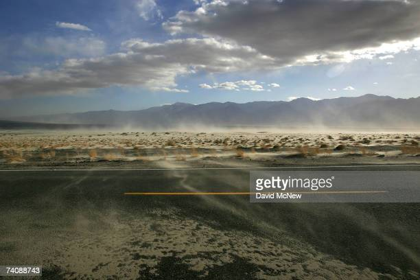 High winds blow sand across the highway near the original north shore of Owens Lake now miles from the nearest pool of water on May 5 2007 near Lone...
