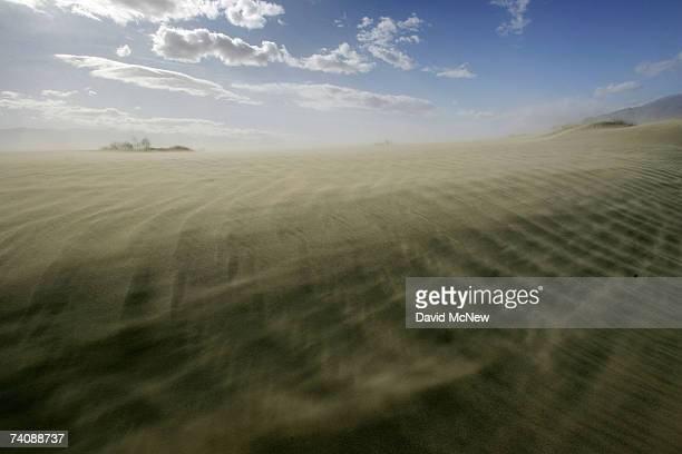 High winds blow sand at the original north shore of Owens Lake now miles from the nearest pool of water on May 5 2007 near Lone Pine California The...