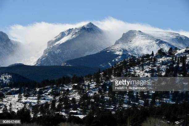 High winds blow snow high in the peaks of Rocky Mountain National Park on January 22 2018 in Estes Park Colorado Due to the government shutdown all...
