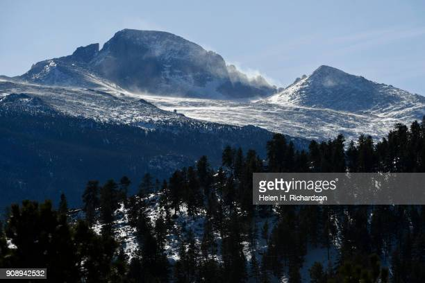 High winds blow snow on Longs Peak in Rocky Mountain National Park on January 22 2018 in Estes Park Colorado Due to the government shutdown all...