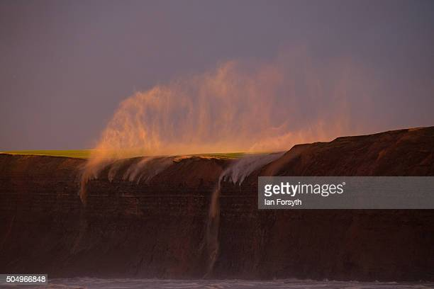 High winds blowing off the North Sea force rainwater from fields back over the cliff edge at Huntcliff on January 14 2016 in Saltburn bytheSea...