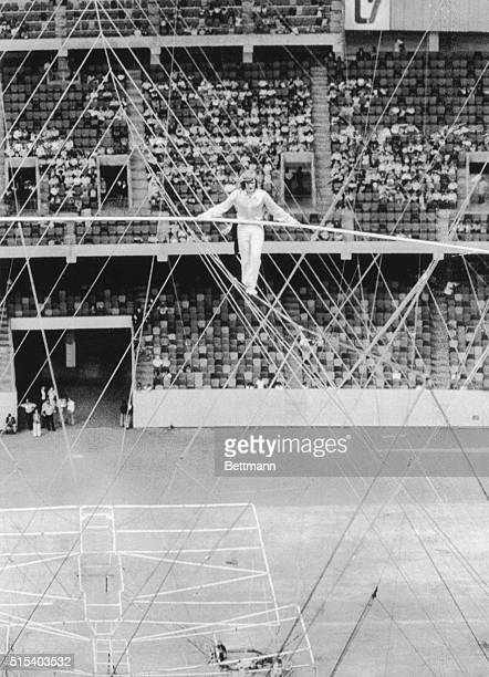High wire dare devil Philippe Petit makes his way across the cable suspended 200 feet above the floor of the Louisiana Superdome The stuntmen...