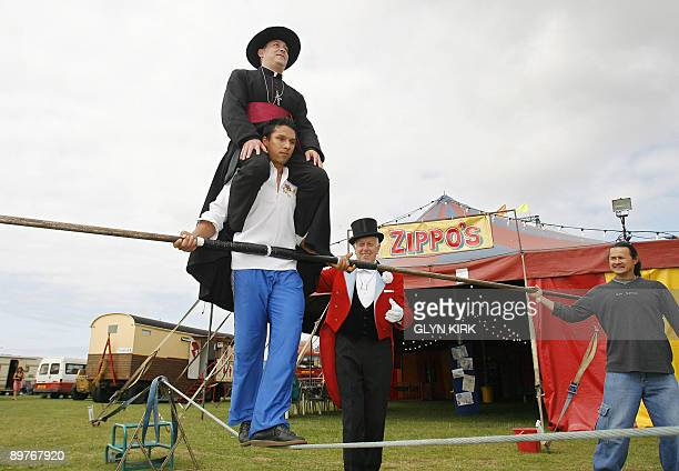 High wire walker Chico Marinhos, practices carrying local priest Father Jerome Lloyd, as he prepares to achieve the same feat across a wire suspended...