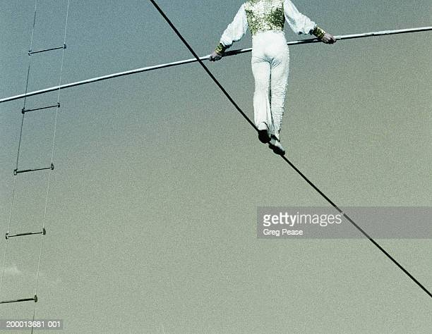 High wire walker, rearview, low angle view