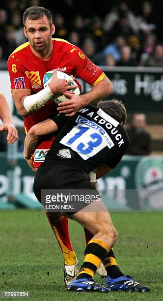 High Wycombe, UNITED KINGDOM: Dominic Waldouck of London Wasps tackles Guillaume Bortolaso from USA Perpignan during the round 5 match of the 12th...