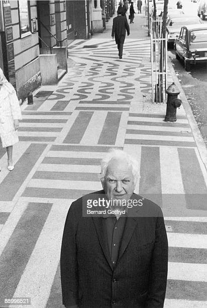 Highangle portrait of American sculptor Alexander Calder as he poses on Madison Avenue just north of 78th Street New York New York 1970s