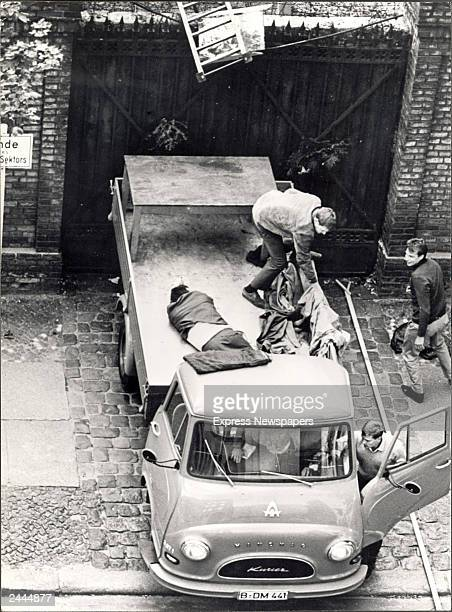 Highangle shot of Stanislaus Gefroerer laying in the back of a lorry after crossing the Berlin Wall by ladder fearing that guards may have seen him...