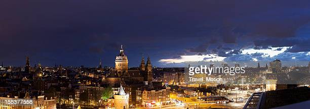 High-angle view Amsterdam cityscape at night, panorama