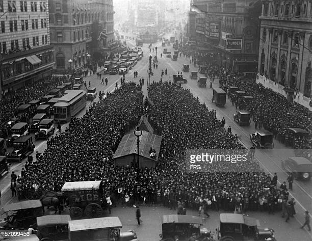 High-angle view looking north from the Times Tower , at the intersection of Broadway and Seventh Avenue at 42nd Street, of crowds waiting at Times...