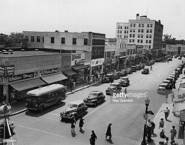 Highangle view of a pedestrians and automobile traffic on a busy main street in Hempstead New York