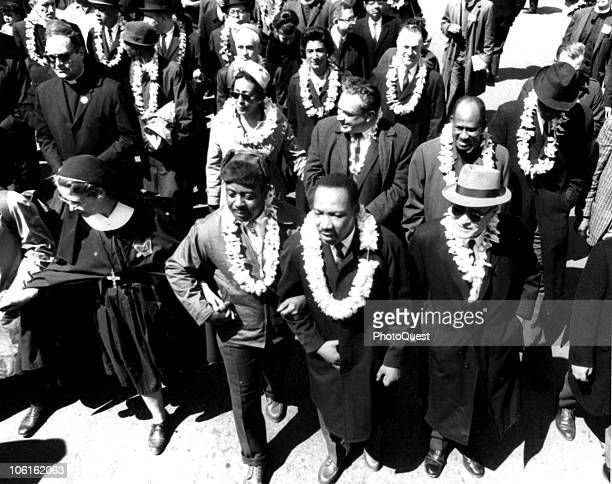Highangle view of American Civil Rights leader Dr Martin Luther King Jr flanked by Reverend Ralph Abernathy and Nobel Prizewinning political...