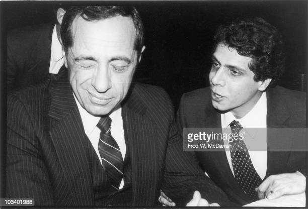 Highangle view of American politician Mario Cuomo and his son and campaign advisor Andrew Cuomo as they attend a Liberal Partyfundraising dinner...