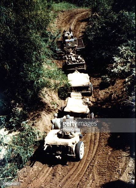 Highangle view of an artillery tractor of the 135th Field Artillery as it pulls a an ammunition train along a dirt road near the Cagayan Valley Luzon...