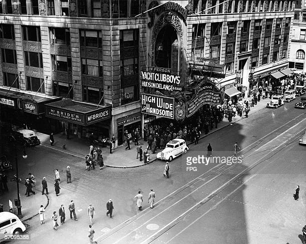 Highangle view of crowds waiting on the street outside the Paramount Theatre in Times Square before a screening of the musical 'High Wide and...