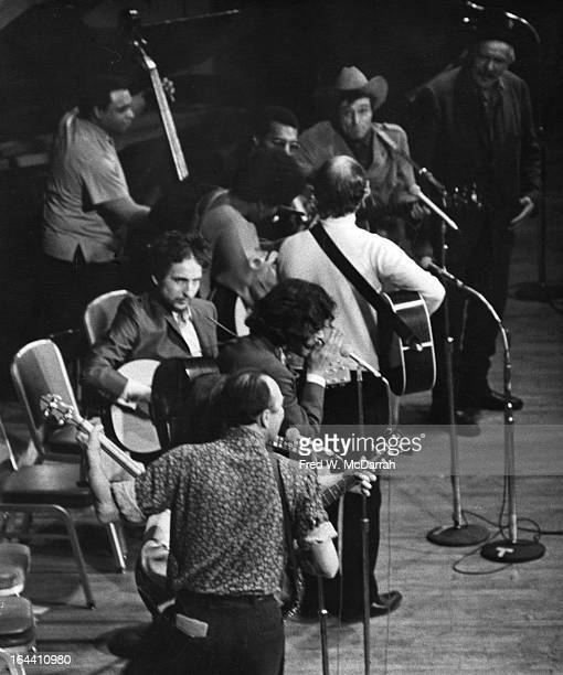 Highangle view of performers on the stage for a Woody Guthrie tribute at Carnegie Hall New York New York January 20 1968 Among those pictured from...