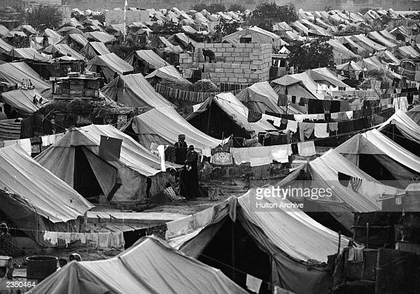 High-angle view of tents in a UNRWA administered camp for homeless Palestinian Arab refugees near Damascus, Syria, 1967.