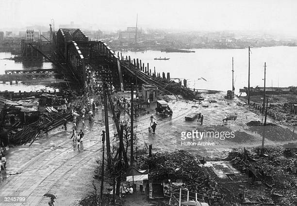 High-angle view of the area around the Eitai Bridge, looking toward Fukagawa, which was damaged from fires after the Kanto earthquake, Tokyo, Japan.