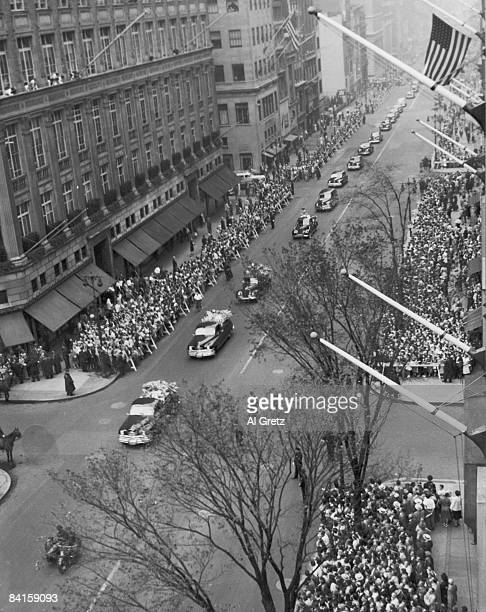 Highangle view of the funeral morocade in honor of American baseball player Babe Ruth as it travels along the crowdlined Fifth Avenue New York New...
