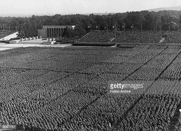 Highangle view of the Nazi Party Congress with 25000 people standing in the arena before the German Fuhrer Adolf Hitler and his Third Reich party...
