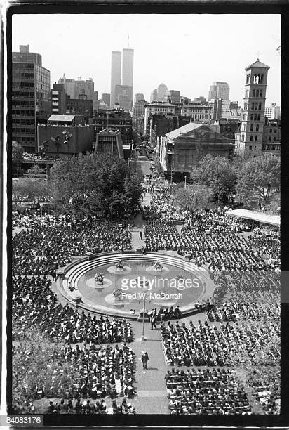 Highangle view of Washington Square Park during a New York University graduation ceremony New York New York May 1992 The twin towers of the World...