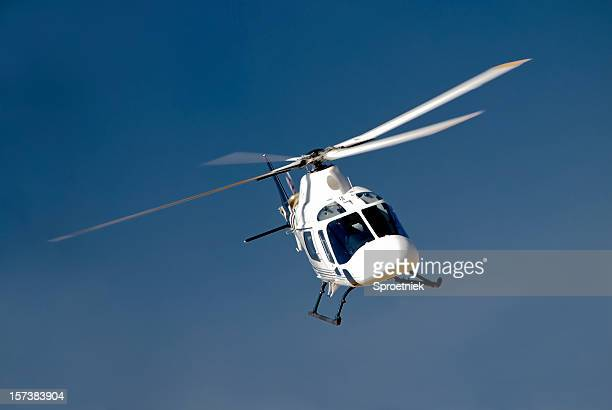 high-banking helicopter - helicopter photos stock pictures, royalty-free photos & images