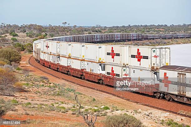 High-capacity SCT freight train passing dry salt lake