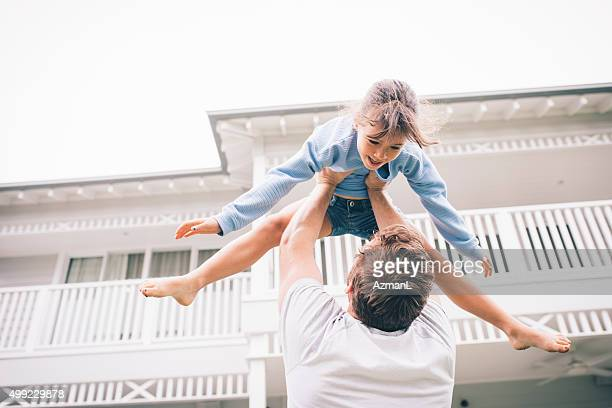higher, daddy! - throwing stock pictures, royalty-free photos & images